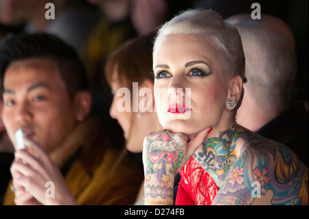 Austrian tattoo model Lexy Hell sitting in the front row of the Marc Stone fashion show during the Mercedes-Benz - Stock Photo