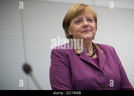 German Chancellor Angela Merkel (L) sits during a meeting of the CDU/CSU parliamentary party in Berlin, Germany, - Stock Photo