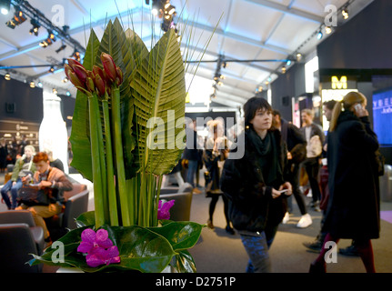 Visitors pass through the Mercedes-Benz Fashion Week tent in Berlin, Germany, 15 January 2013. The presentations - Stock Photo