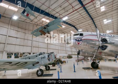 Beech AT-11 Kansan, Douglas DC-3A Dakota, with 1911 Curtiss Triad replica overhead, at Lone Star Flight Museum, - Stock Photo