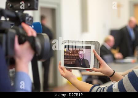 Regensburg, Germany, 16th January 2013. A television crew films a tablet computer which shows an interview with - Stock Photo
