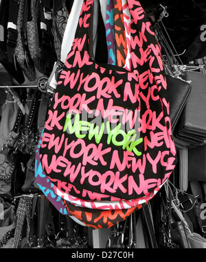 NEW YORK Handbag for sale in a Chinatown tourist shop on Canal Street in lower Manhattan. Colors manipulated in - Stock Photo