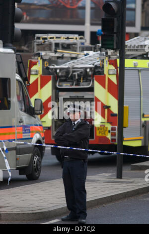 London, UK. 16th January 2013. Aftermath of a helicopter crash into the crane constructing the residential skyscraper - Stock Photo