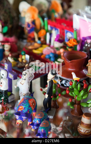 Collection of Day of the Dead models and figurines in Cabinet - Mexico - Stock Photo