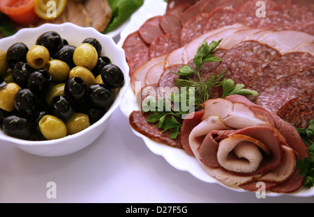 Olives and sausage on a celebratory table - Stock Photo