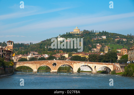 Ponte Pietra bridge with Santuario della Madonna di Lourdes church in background Verona city the Veneto region northern - Stock Photo