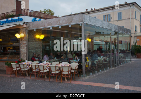 Cafe with glass walls and ceiling at waterfront Bardelino town Lago di Garda the Garda Lake the Veneto region Italy - Stock Photo