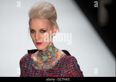 Austrian-born tattoo model Lexy Hell presents a creation at the Anja Gockel show during the Mercedes-Benz Fashion - Stock Photo