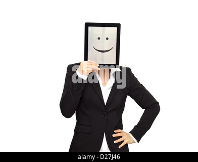 Business woman hiding behind a digital tablet with a happy smiley face. - Stock Photo