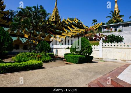 Shwedagon Pagoda,Buddhas,Buddhism Offerings,Southern Entrance,Outlying Buildings,Buddhist Bells,Yangon,Myanmar,Rangoon,Burma - Stock Photo