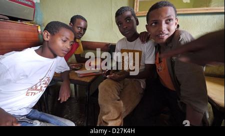 ETHIOPIA The 'Salam Cafe' in Chagni, Beni Shangul Gumuz region. Boys having breakfast.