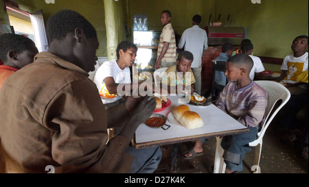 ETHIOPIA The 'Salam Cafe' in Chagni, Beni Shangul Gumuz region. Boys having breakfast of beans.