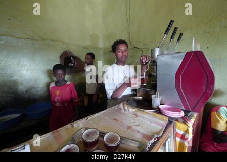 ETHIOPIA The 'Salam Cafe' in Chagni, Beni Shangul Gumuz region. Employees using espresso machine.