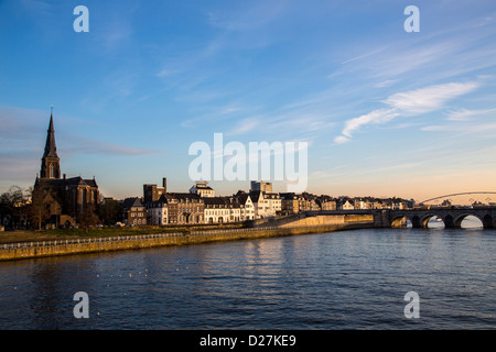 Skyline, eastern parts of the city on the river Maas, center, Cargo Ship, Maastricht, Limburg, Netherlands, Europe. - Stock Photo