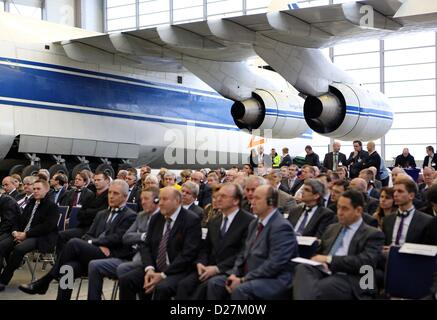 Leipzig/Halle in Schkeuditz, Germany, 16th January 2013. People sit in front of a Antonov 124 during the opening - Stock Photo