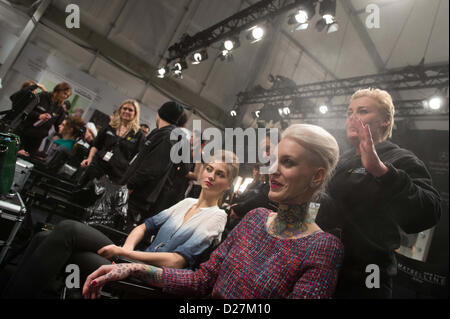 Austrian-born tattoo model Lexy Hell gets prepared the Anja Gockel show during the Mercedes-Benz Fashion Week in - Stock Photo