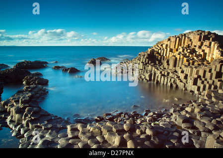 Beautiful day in the afternoon sun on the famous Giant's Causeway on the Antrim Coast of Northern Ireland - Stock Photo