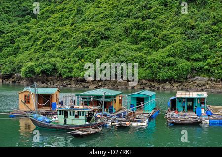 Floating village houses, Halong Bay, Vietnam - Stock Photo