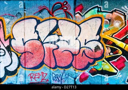 Graffiti street art tag on a wall, UK - Stock Photo