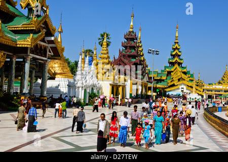 Shwedagon Pagoda,Buddhas,Buddhism Offerings at Planetary Posts,Outlying Buildings,Buddhist Bells,Yangon,Myanmar,Rangoon,Burma - Stock Photo