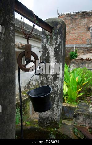the well with bucket (The Water Castle in Yogyakarta - Taman Sari) - Stock Photo