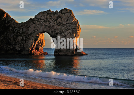 Durdle Door, a natural limestone arch at sunset along the Jurassic Coast near West Lulworth in Dorset, southern - Stock Photo