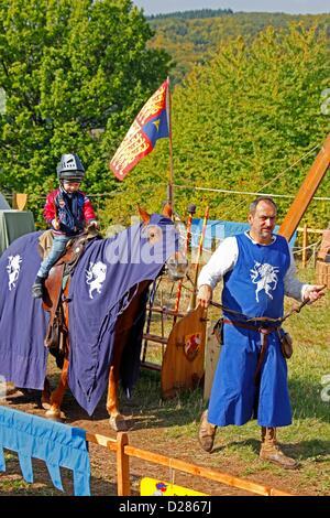 Knights Tournament for children, Ronneburg, Hesse, Germany - Stock Photo