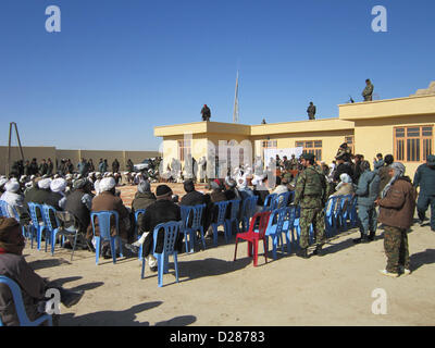 Provincial and district leaders from Farah province take part in a security shura at the Bala Boluk district center, - Stock Photo