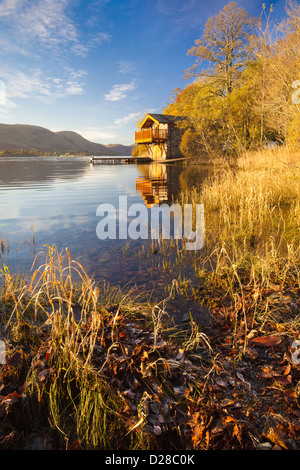 A boathouse near Pooley Bridge in the Lake District National Park.  Captured from the waters edge on a cold still - Stock Photo
