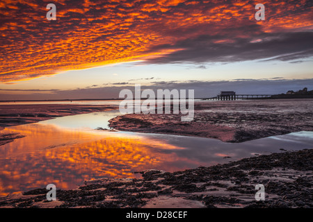 The RNLI station on Roa Island near Barrow in Furness in Cumbria captured at sunset from the nearby Foulney Embankment. - Stock Photo