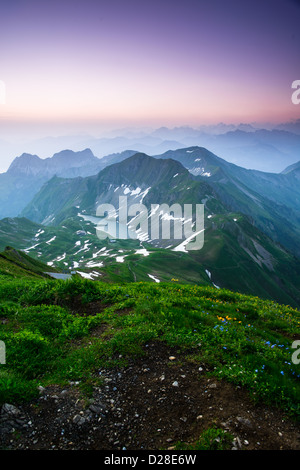 Sunrise mountain panorama from Brienzer Rothorn with purple sky, Switzerland. - Stock Photo