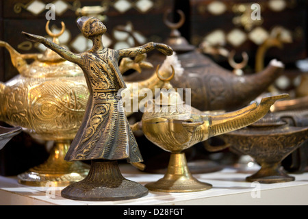 Turkish whirling dancing dervish model souvenir and magic Aladin oil lamp lamps for sale in Grand Bazaar Market - Stock Photo