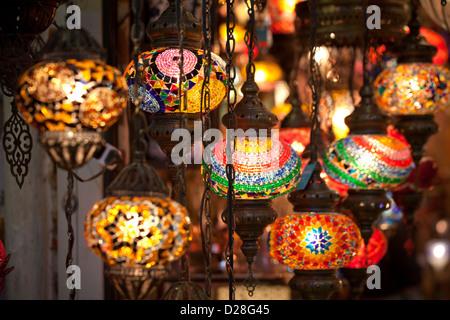 ISTANBUL TURKEY - Grand Bazaar Kapali Carsi Kapalicarsi, hanging colorful electric turkish glass lanterns lamps - Stock Photo