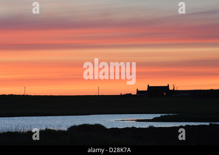 House at sunset beside Loch of Harray, Orkney Islands, Scotland. - Stock Photo