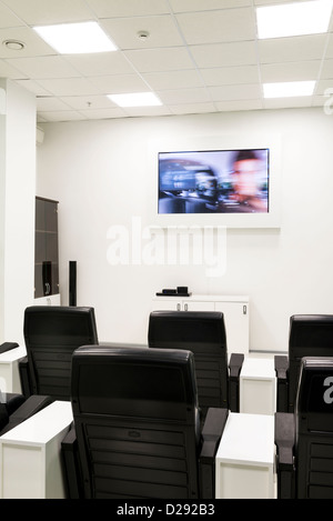 ... Conference or training cinema room. Blurred action video on the screen  - Stock Photo