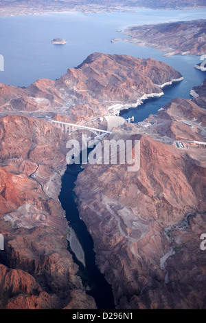 flying over the hoover dam and the arizona Nevada border on the colorado river USA - Stock Photo