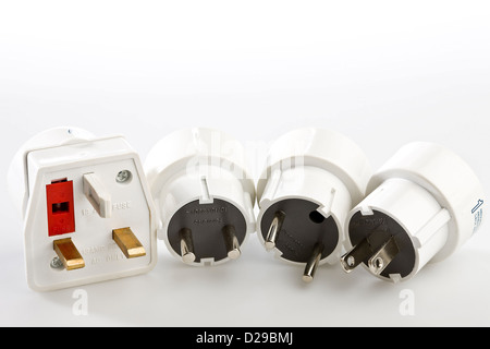 Four adaptor plugs for European, Af - Stock Photo