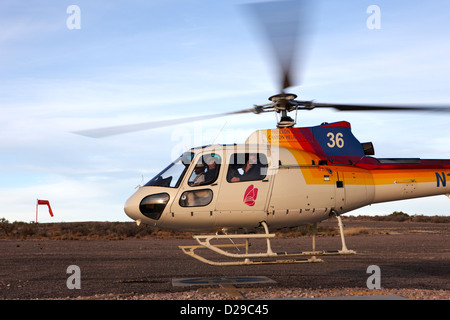 papillon helicopter tours full of passengers taking off from helipad Grand canyon west airport Arizona USA - Stock Photo