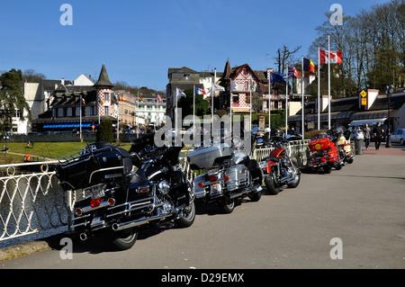 Motorbikes ('Harley Davidson') parked on a sidewalk in Bagnoles de l'Orne, unique spa resort in the west of France - Stock Photo