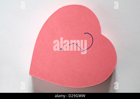 ? message written on pink heart shaped post it note pad isolated on white background - Stock Photo