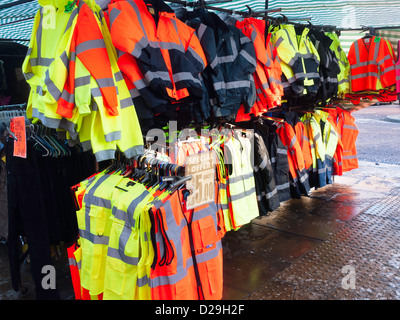 Low cost high visibility  work clothing on sale from a market stall in the North of England - Stock Photo