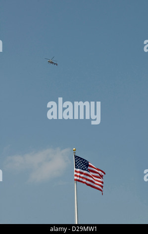 Helicopter and american flag - Stock Photo