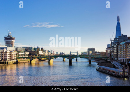 Southwark bridge over The River Thames and the city of London, England, UK - with the Shard - Stock Photo
