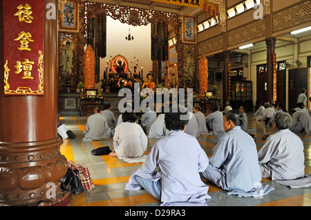 Buddhist women praying at Long Son Pagoda, Nha Trang, Vietnam - Stock Photo