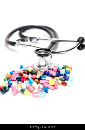 Berlin, Germany, colorful pills and stethoscope on a white background - Stock Photo
