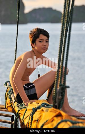Teenage boy tourist on a boat in Ha long Bay, Vietnam - Stock Photo
