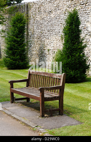 Wooden bench in a park in Winchester, Hampshire, UK - Stock Photo