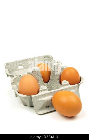fresh brown eggs in an open box - Stock Photo