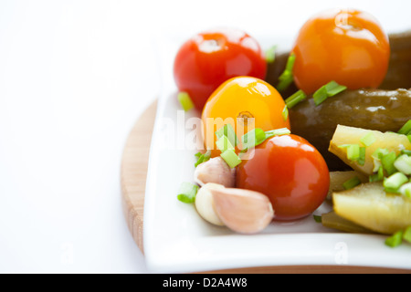 pickled vegetables on a white square plate, closeup - Stock Photo