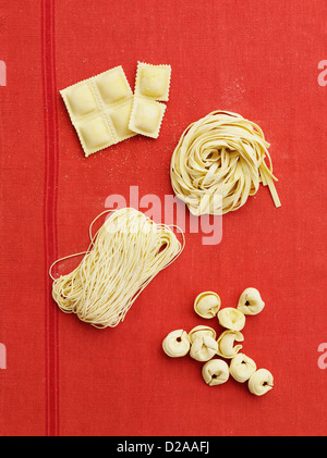 Fresh pasta varieties on cloth - Stock Photo